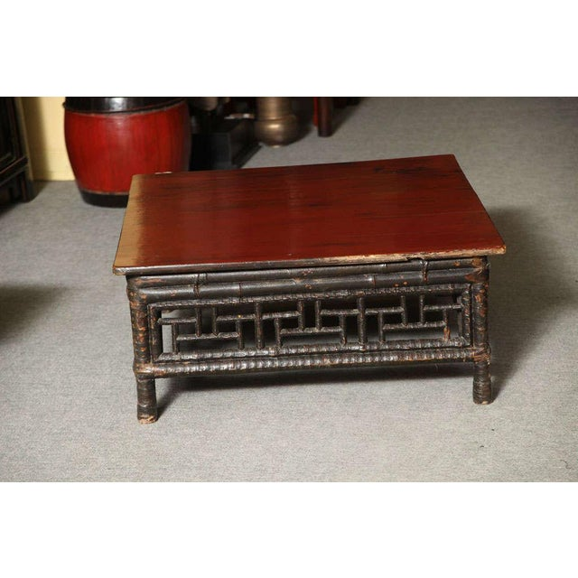 Asian Small 19th Century Chinese Bamboo with Red Lacquered Top Coffee Table For Sale - Image 3 of 11