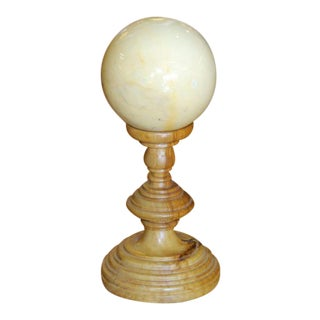 Marble Sphere on Wooden Pedestal For Sale