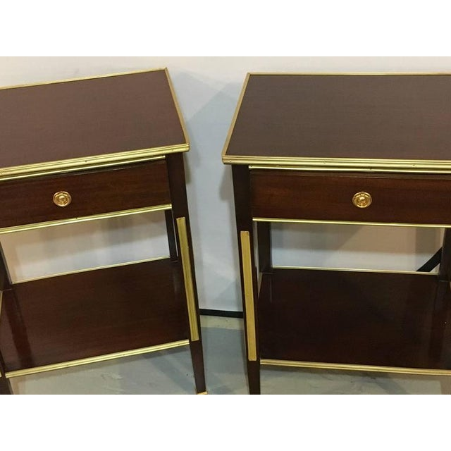 Pair of one drawer Russian style bronze-mounted end tables or night stands. Having been professionally polished and...