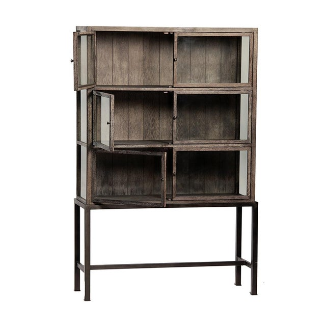 Grey wash oak frame cabinet with glass doors and an iron base. This piece can work in a variety of rooms and can be used...