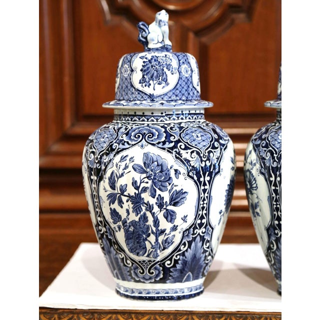 Place this large and elegant pair of vintage ceramic ginger jars on a mantel, created in Holland, circa 1960, the faience...