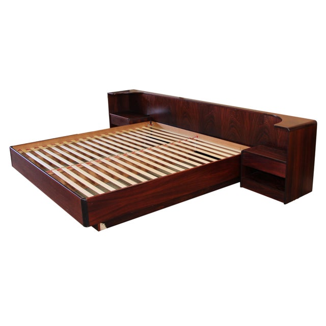 This is an amazing Danish Rosewood king size platform bed, made in Denmark. Very Good Vintage Condition: There are large...