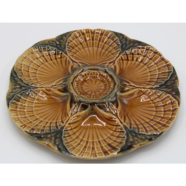 NEW SHIPMENT FROM FRANCE! Mid-Century French Majolica Sarreguemines Oyster Plate, circa 1930s. The colors are a blend of...