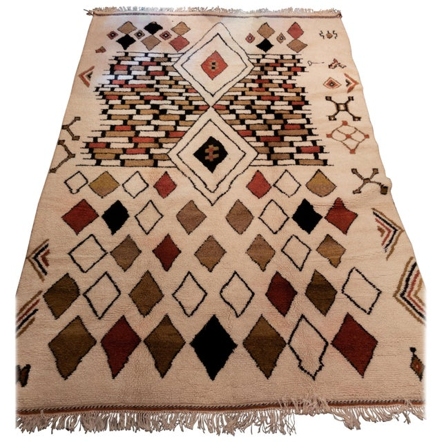 This rug has been traditionally handwoven in one of Morocco's most remote mountainous villages. This piece reflects the...