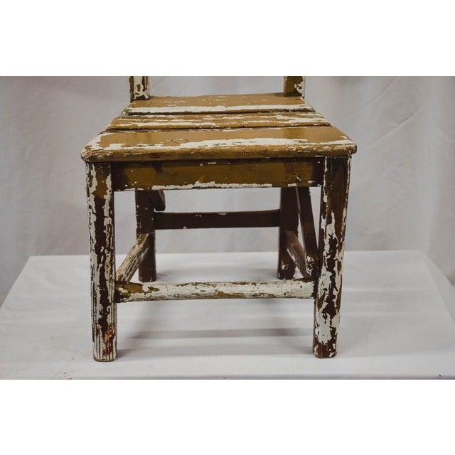 A cute vintage child's chair from France. Handmade from pine with a charming chippy white painted patina. This would...