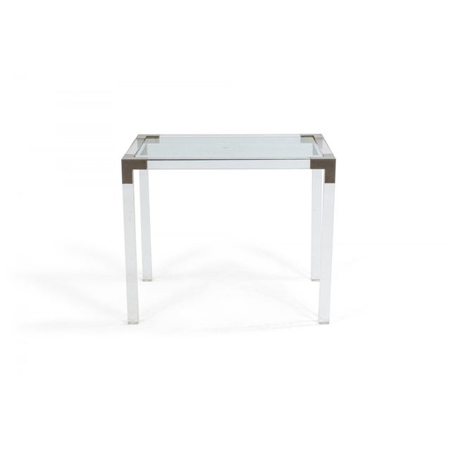 Set of 3 French Mid-Century lucite nesting tables with accented metal hardware and glass shelves in the style of Maison...