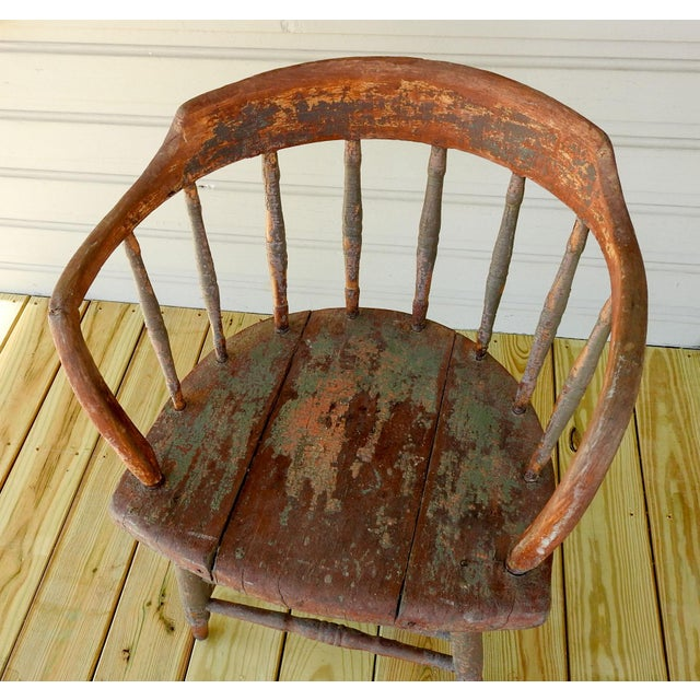 Antique saloon chair with several layers of different colored chipped paint. Has a couple repairs, but very sturdy. Seat...