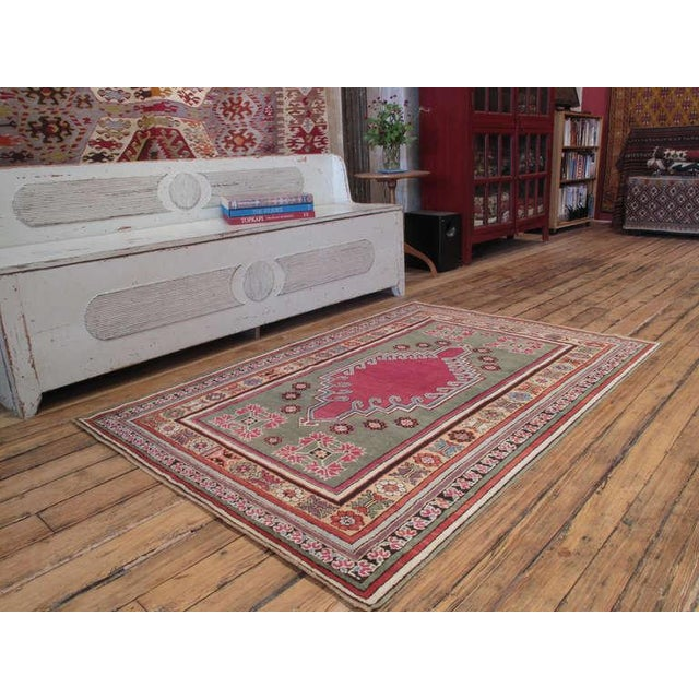 A lovely antique Central Anatolian rug, from a region well-known with its prayer rugs, featuring a more unusual design....