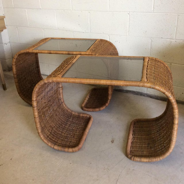 The hard to find wicker waterfall table in a pair! The waterfall table never goes out of style. Classic mid-century look....