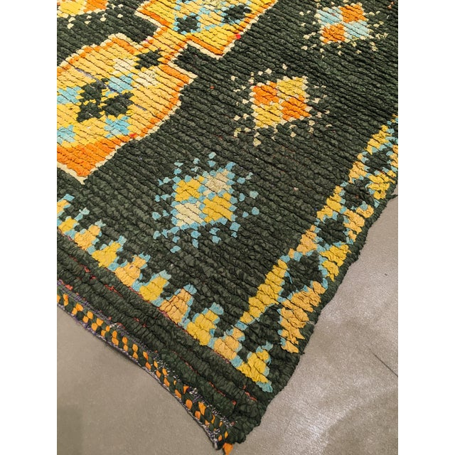 A vintage hand knotted wool Moroccan rug, circa 1950/1960. A chocolate brown field with five interconnected medallions....