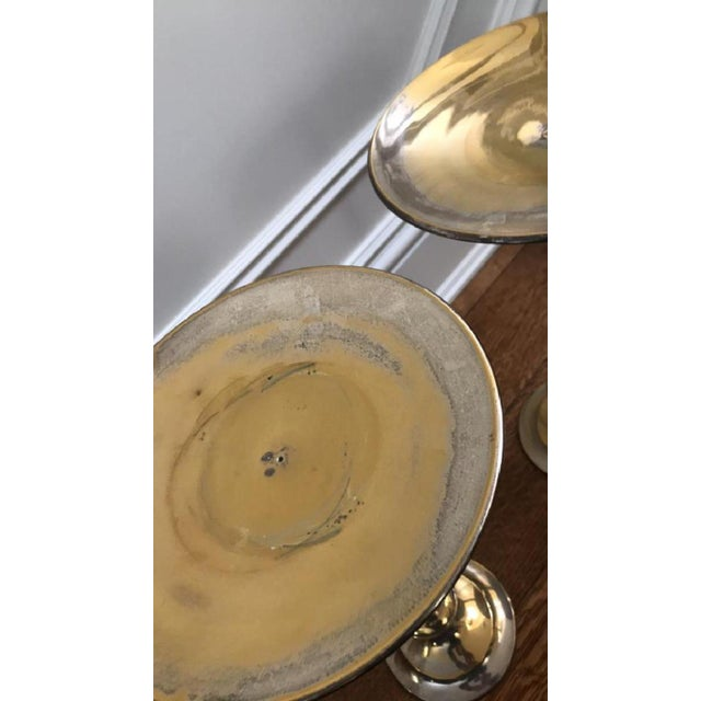 """Pair of silver brass plated floor candlestands. Dimensions: H 15.5"""" X D 9"""" Condition shows heavy losses to plating shows..."""