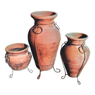 Terra Cotta Italian Oil Vessel Amphora Shaped Planters on Stands With Iron Braces - Set of 3 For Sale