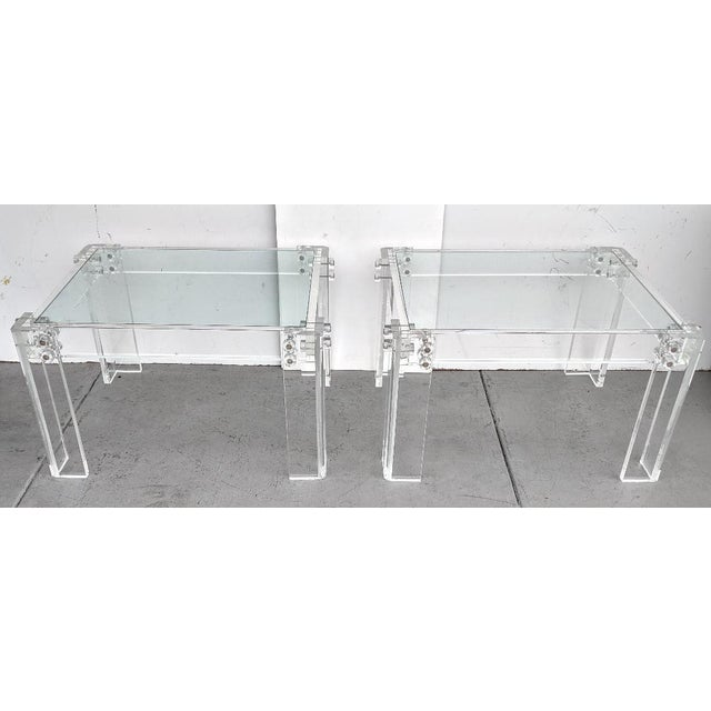 This is a vintage pair of lucite side/cocktail tables, they have great industrial lines to them, with their bolted...