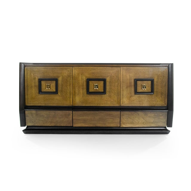 A very chic dual tone credenza original from Italy, 1940-1949. Case has been expertly restored, each door opens up to...