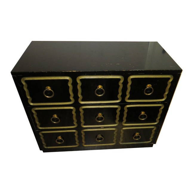 Vintage chest of drawers in the style of Dorothy Draper. Features a classic black lacquer case and drawers with gold leaf...