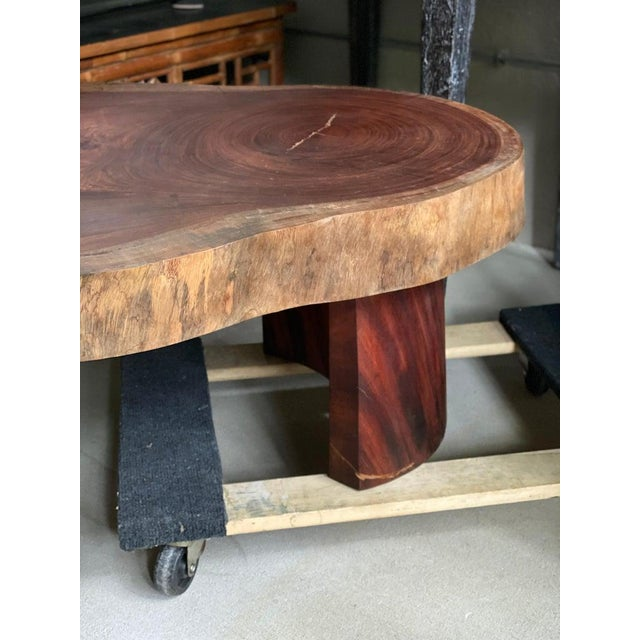 Solid 4 inch slab of mahogany in matte finish with arched legs. Mid century Modern meets organic modern, from Belgium, 1960s.