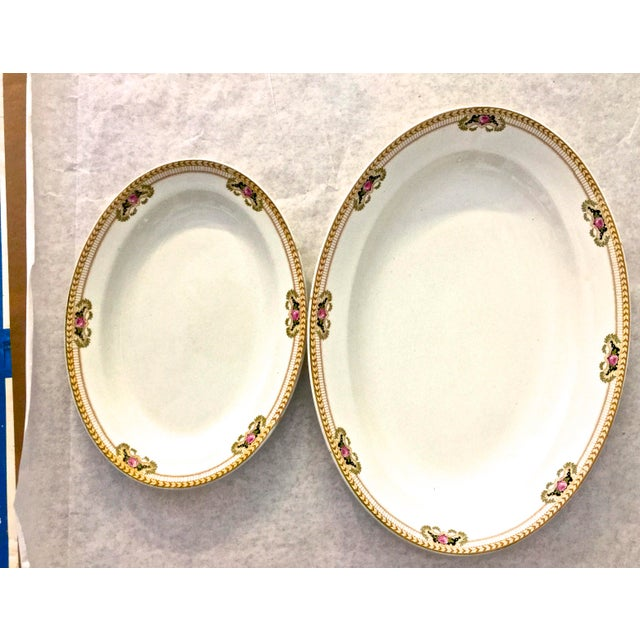 Lovely vintage serving platters in a set of 2. The design is pink roses set in black with a wreath of laurel leaves...