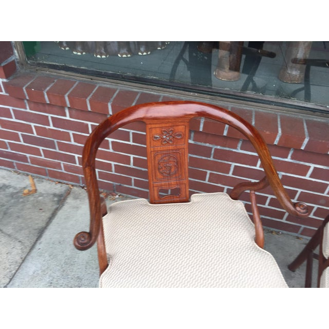 Gorgeous pair of Chinese Horseshoe chairs made from Rosewood. In excellent condition. New cushions. Late 20th century. The...