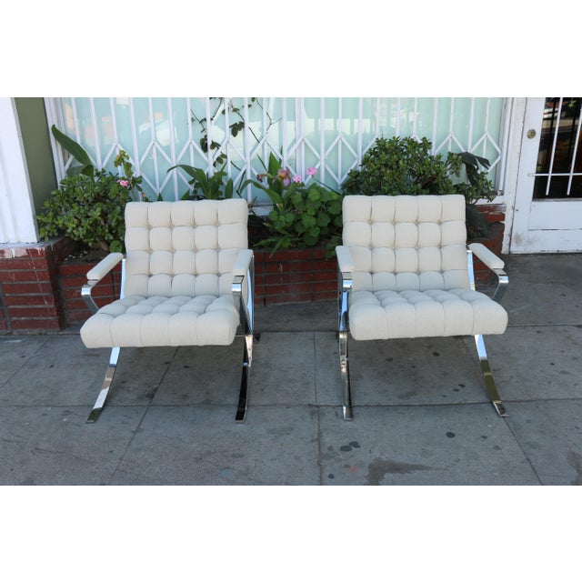 Pair of steel chrome vintage lounge chairs in excellent beautiful condition. They have both been reupholstered. Steel...
