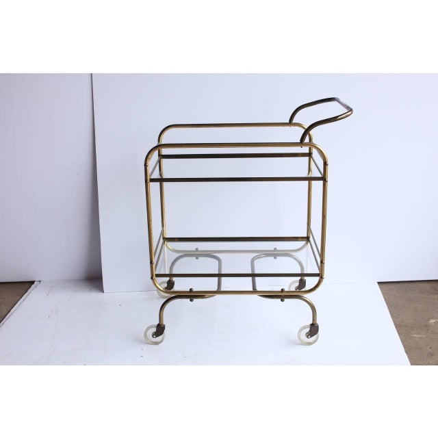 Mid century brass and glass bar cart. This piece would be a great addition to a home that loves to hosts dinners and events.