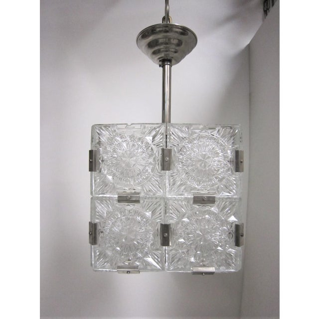 Multiple pendant squares available. Priced here as a set of three. Modernist square chandeliers comprising 20 squares of...