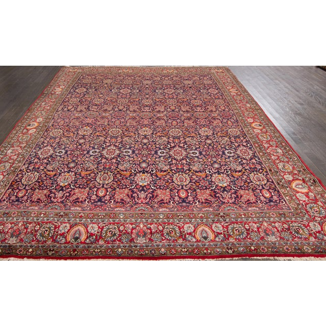 Vintage, hand-knotted Persian Rug, with an allover design on a red field. This rug has pristine detailing and is ready for...