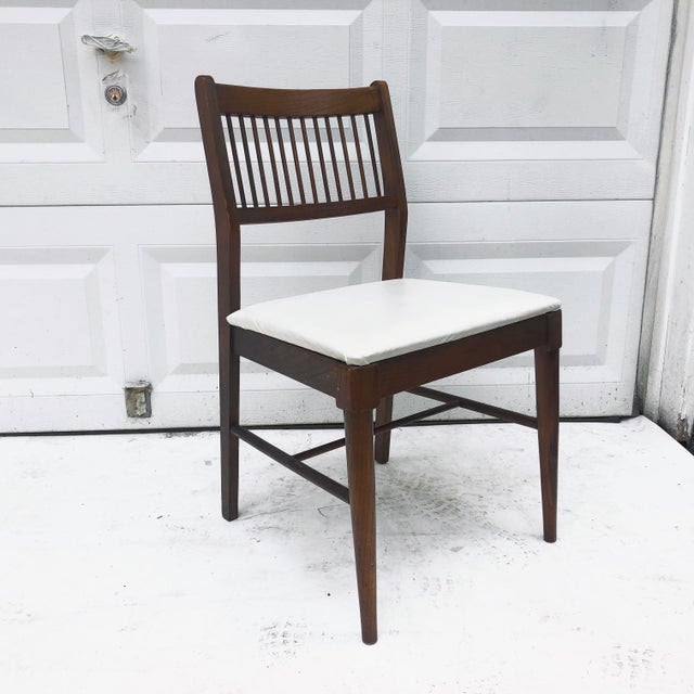 This stylish Mid-Century Modern dining chair features unique spoke seat back, upholstered seat, and tapered legs. Sturdy...