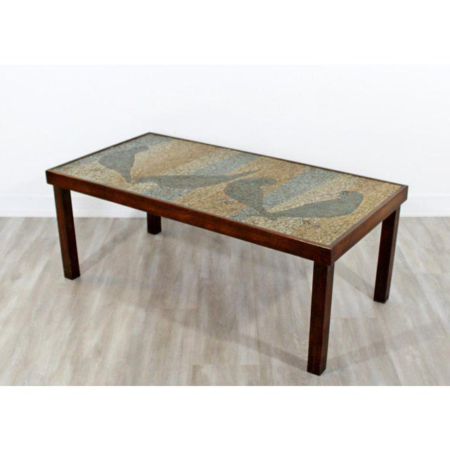 For your consideration is a beautiful, mosaic tile topped, rectangular coffee table, with a bird motif, circa the 1960s....