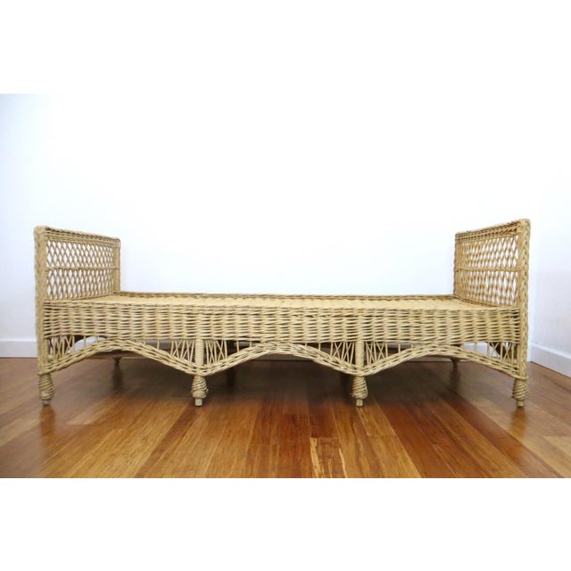 Gorgeous long vintage wicker daybed, most likely made by Bar Harbor. It is made of extremely sturdy woven willow. It is...