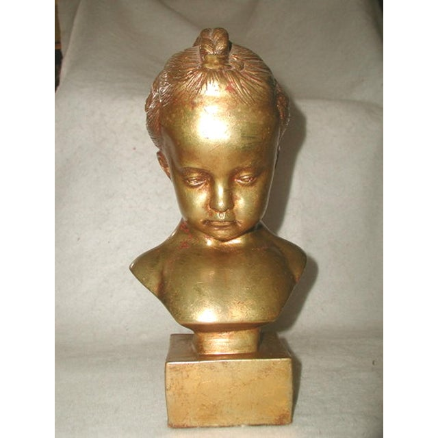 Italian plaster bust sculpture of a young girl C.1890-1905 was finished with the old gilt. Some of the red undercoating...