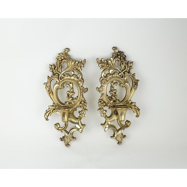 Vintage pair of Syroco wood candles sconces. Carved in a beautiful floral and scroll motif. They would look stunning above...