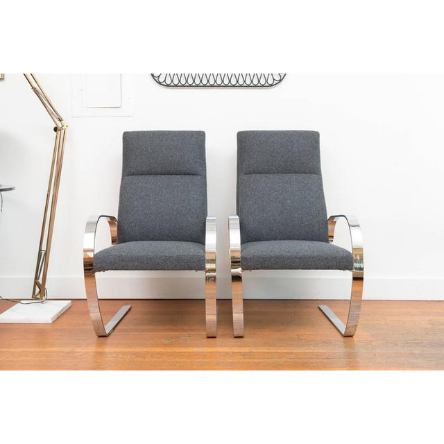Handsome pair of chrome cantilever armchairs in a felted wool. Extremely comfortable and have a spring to them when your...