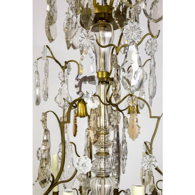 A grand, early 20th century, Belle Epoque, gilded bronze chandelier, soaring nearly 4 feet tall. Sharply cut and...