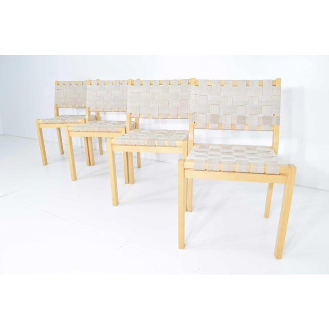 """A set of eight Alvar Aalto 615 chairs with birch frames and flax webbing. Chair has a birchwood frame and high-quality 2""""..."""
