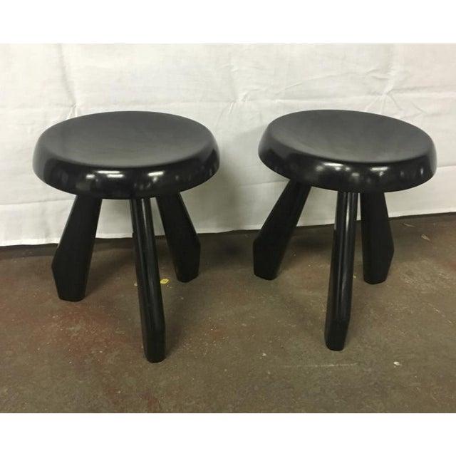 "Charlotte Perriand pair of rare black model ""Sandoz"" tripod stool."