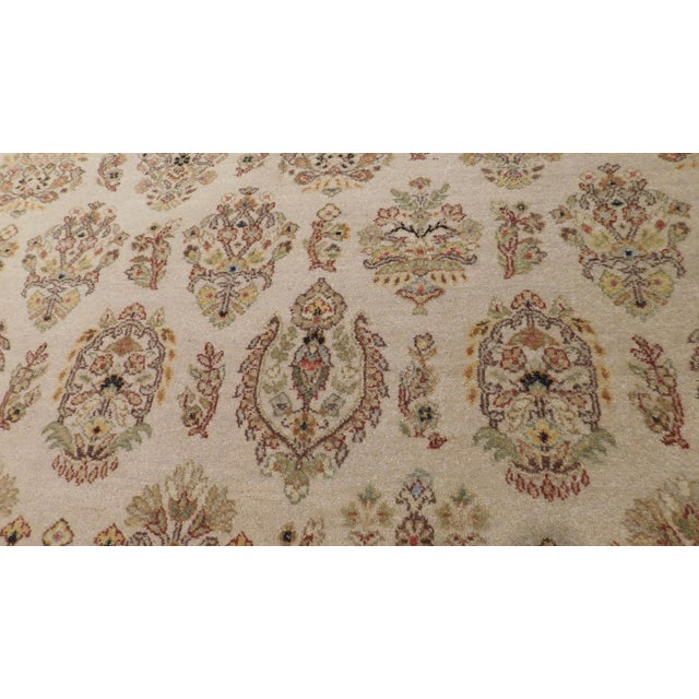 An all over array of stylized flowers on a neutral beige background offers enduring character and cultured pattern. Hand...