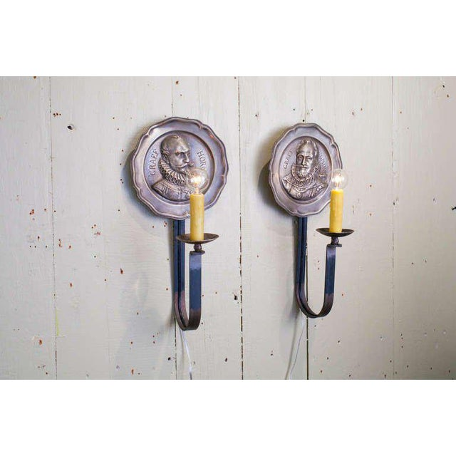 Unusual vintage pewter sconces with profiles of men in Renaissance style clothing. Iron arms with candelabra sockets....