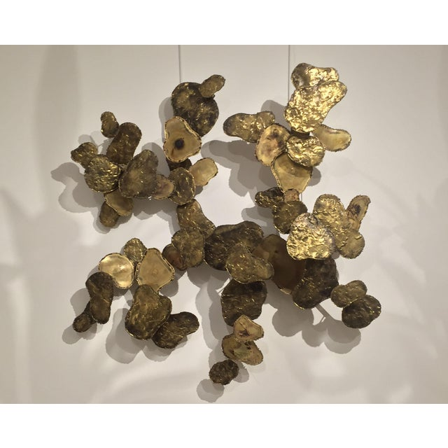 """Mid-Century American wall sculpture of """"sunspots"""" hand-cut bronze, steel, copper and brass signed by Silas Seandel, 1979."""