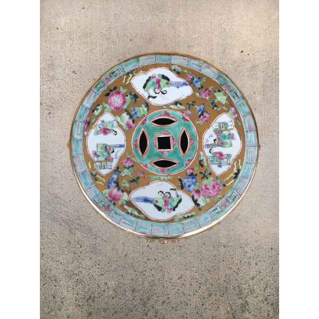 Ceramic garden stool with cut-out designs, raised bosses, intricately painted with extraordinary detail, and glossy...