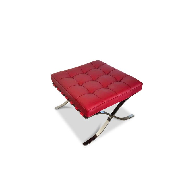 """Pair of Barcelona ottomans by Knoll Studios in red leather. Signed """"Knoll Studio Mies van der Rohe"""" on one leg. Knoll..."""