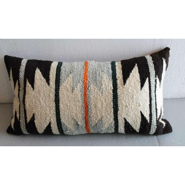 This is a very unusual geometric Navajo Indian weaving bolster pillow in black, cream and grey with a bittersweet stripe....