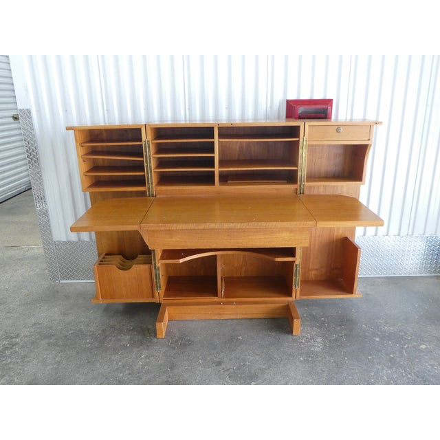 Handsome 1970's Danish Modern style teak veneer magic box desk. Sold as found in vintage condition unrestored showing only...