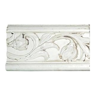 Circa 1918 Embossed White Glazed Front Terra Cotta Brick With Scrolling Foliate Design For Sale