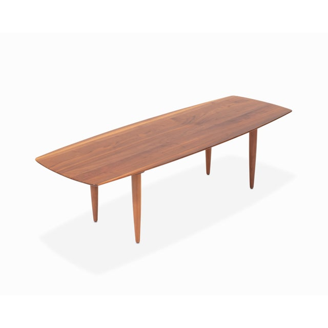 """Here is a solid walnut coffee by Ace-Hi """"Prelude"""". Surfboard style coffee table with tapered legs in beautiful refinished..."""