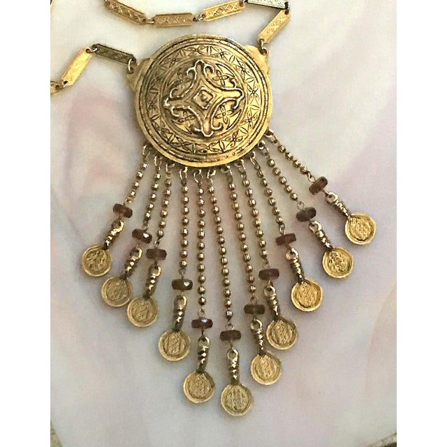 Beautiful statement necklace from Accessocraft...large circular medallion with asian inspired engraving...a total of 11...