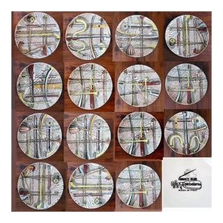 Piero Fornasetti Ceramic Plates Decorated With the Orchestra Pattern. (15 Plates) For Sale