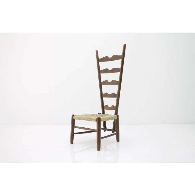 Fireside lounge chair of wood and cane. Gio Ponti, 1939. Measures: H 105 cm, W 40 cm, D 50 cm, SH 30 cm. Very good condition.
