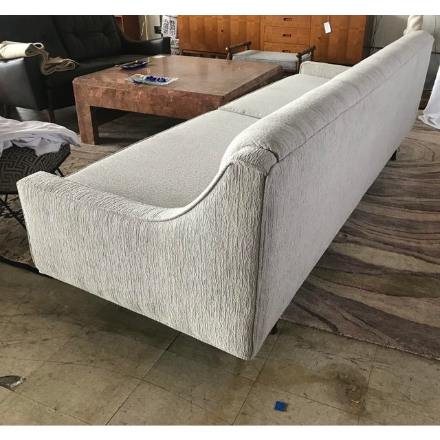 This elegant and sleek designed sofa has been redone down to new foam, dacron and fabric. The tapered legs have been...