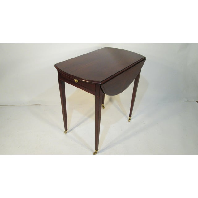 This pembroke table was made by Kaplan furniture from their exclusive Beacon Hill Collection. the table is made of...