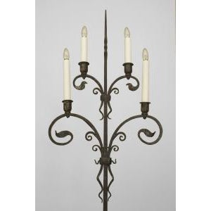 Pair of American Victorian (1910) wrought iron 4 light candlestands with scrolling foliate arms supported on a tripod base...